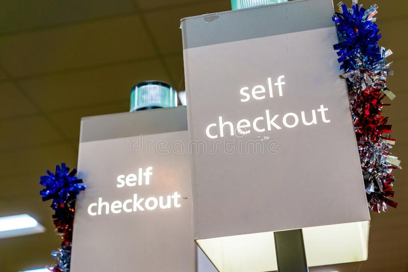 Self Checkout sign in a store stock photography