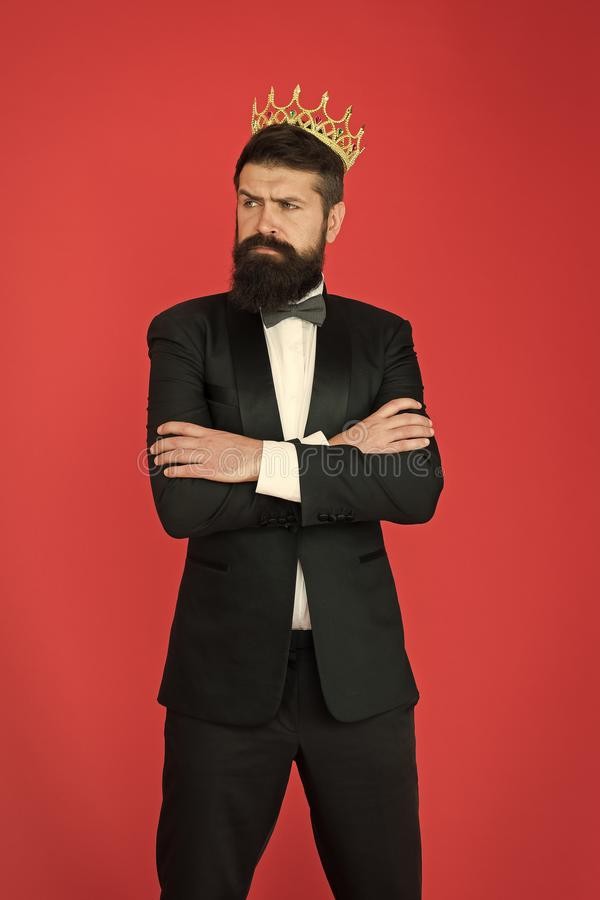 Self confidence concept. Handsome hipster formal suit. Feeling superior. Man bearded handsome guy in formal suit golden stock photography
