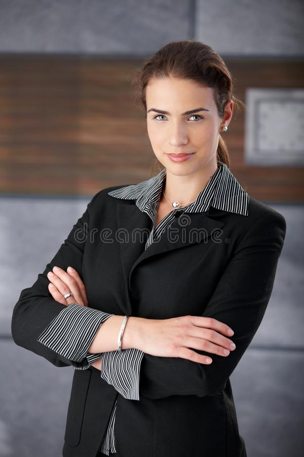 Download Self-confident Businesswoman Smiling Arms Crossed Stock Image - Image: 23609499