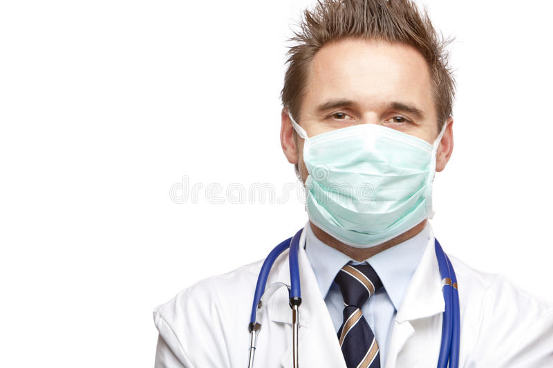 Self confident happy medical doctor with mask stock photos