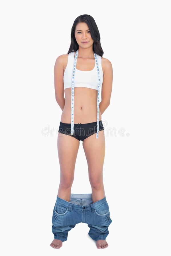 Free Self Confident Woman Wearing Jeans Falling Down Because Shes Los Royalty Free Stock Photography - 32879277