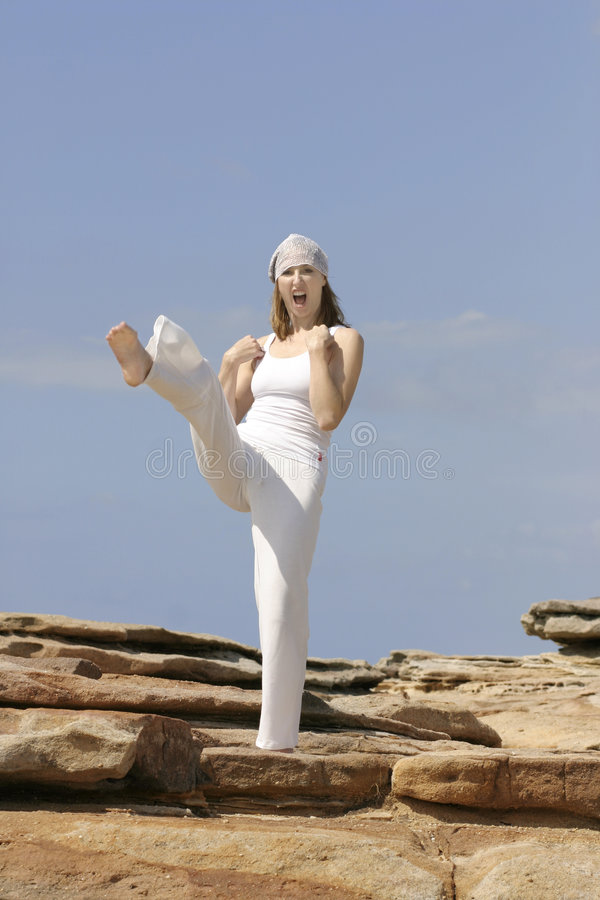 Self Defence. Self defense, fitness, etc. Little bit of motion blur in the foot royalty free stock photography