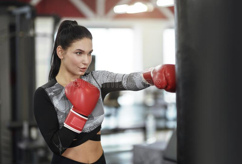 Girl Punching Balls