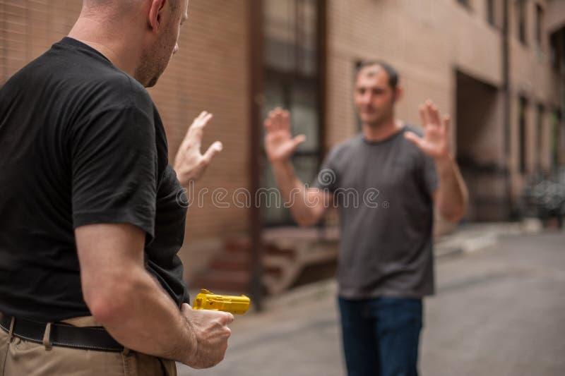 Self defense techniques against a gun. Kapap instructor demonstrates self defense techniques against a gun stock photos