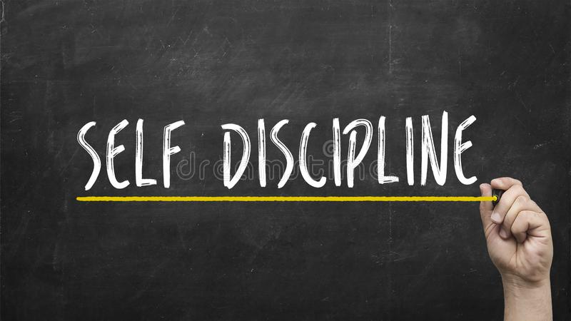 Self discipline concept. Hand writing self discipline inscription text on blackboard. stock photo