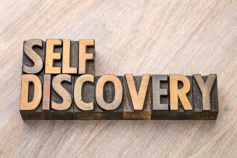 Self discovery word abstract in wood type. Self discovery word abstract in vintage letterpress wood type printing blocks stock image