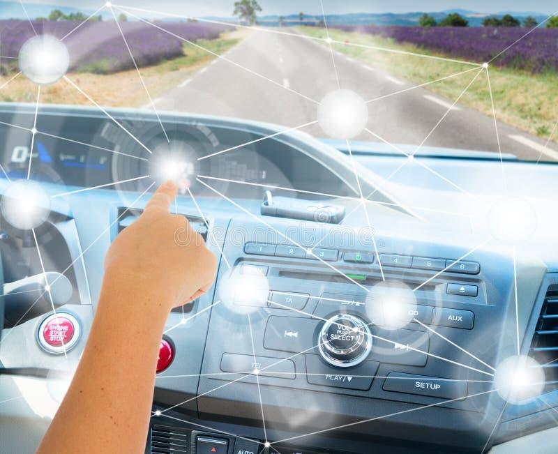 Self-driving car concept. Someones hand programming modern car stock image