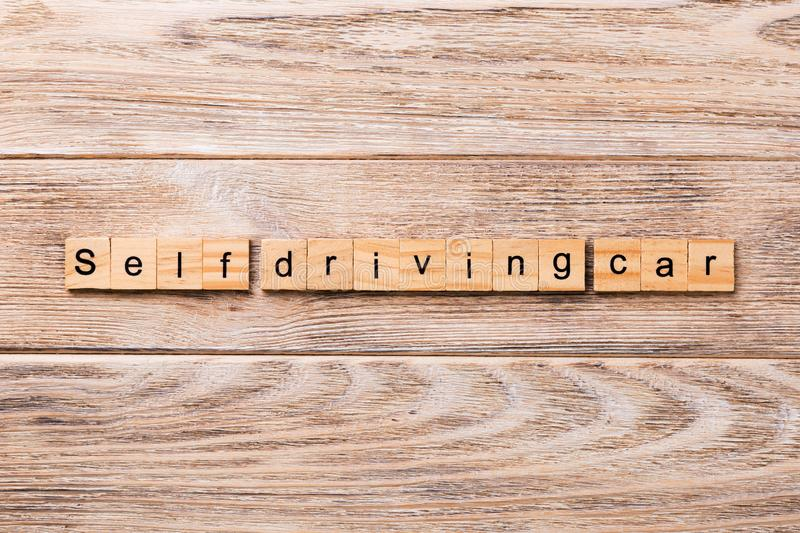 Self-driving car word written on wood block. Self driving car text on wooden table for your desing, concept stock photos
