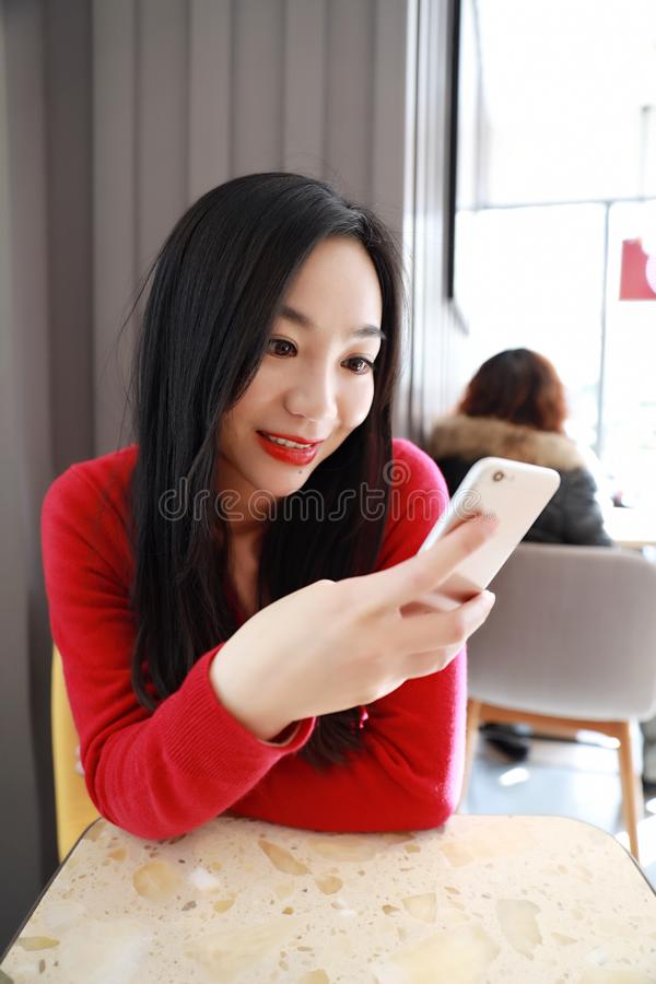 Download Self Employed China Woman Working With Her Phone And Laptop In A Restaurant Stock Photo - Image of asian, coffee: 106428964