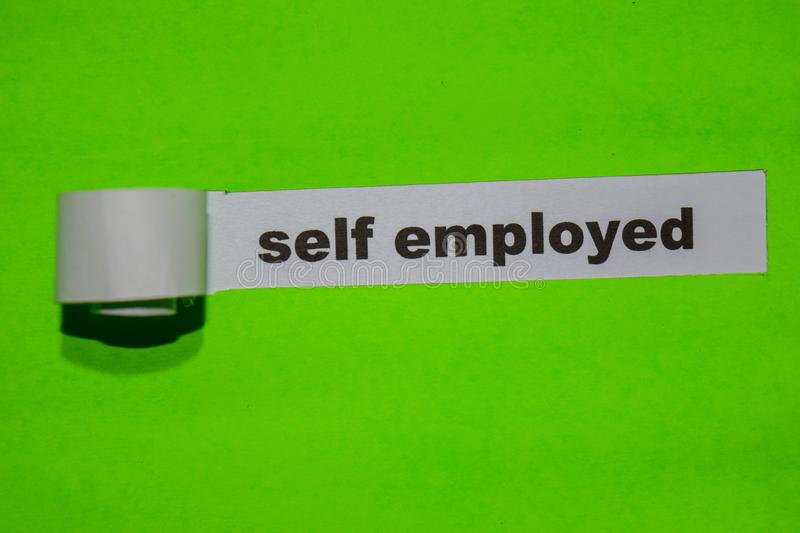 Self Employed, inspiration concept on green torn paper. N stock photography