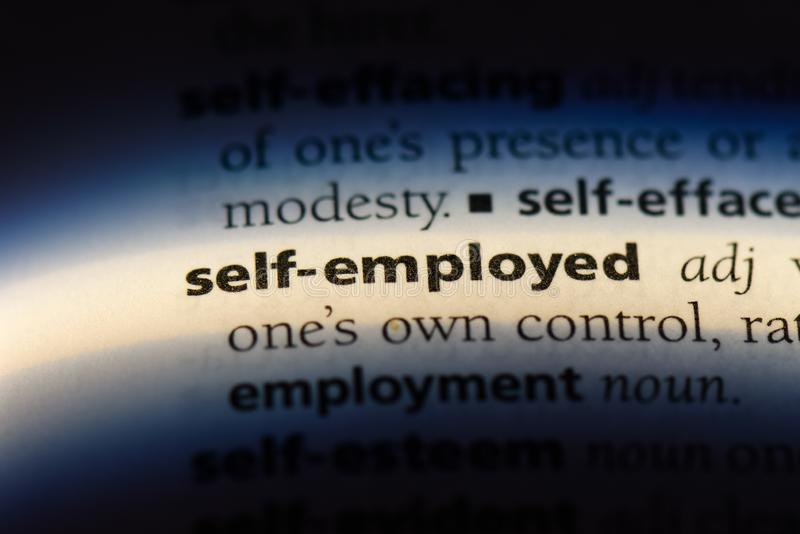 Self employed. Word in a dictionary.  concept stock photo