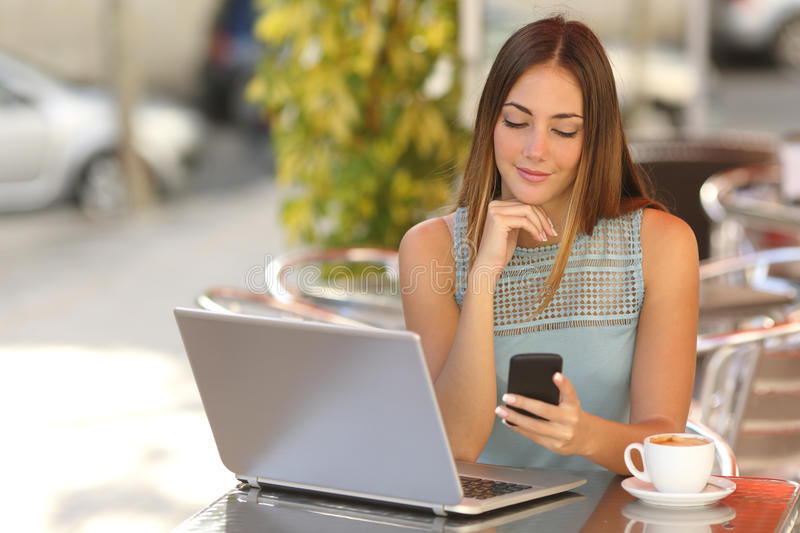 Download Self Employed Woman Working With Her Phone And Laptop In A Restaurant Stock Photo - Image of employed, electronics: 47405774