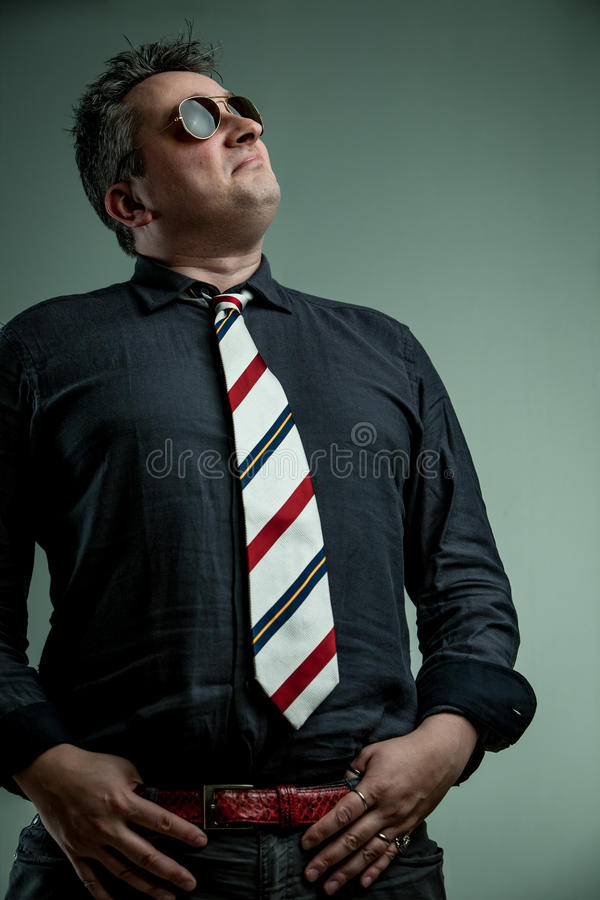 Self-important man feeling ready to command stock photography