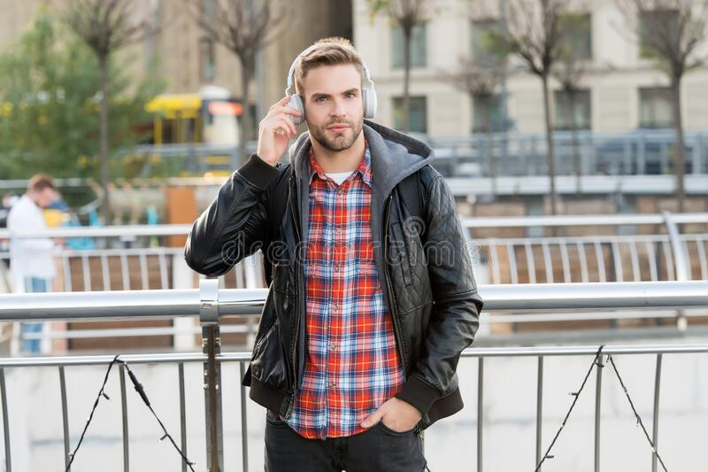 Self improve. Podcast for youth. Online education courses. Listen music. Student study use headphones. Handsome man stock photo
