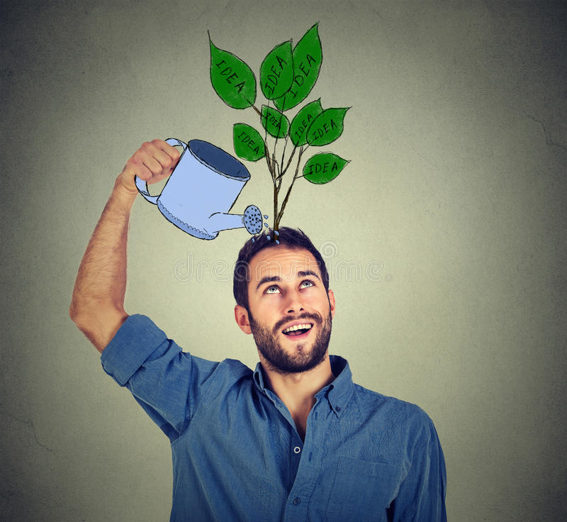 Self investment. man with many ideas. Self investment. Young man with many ideas stock image