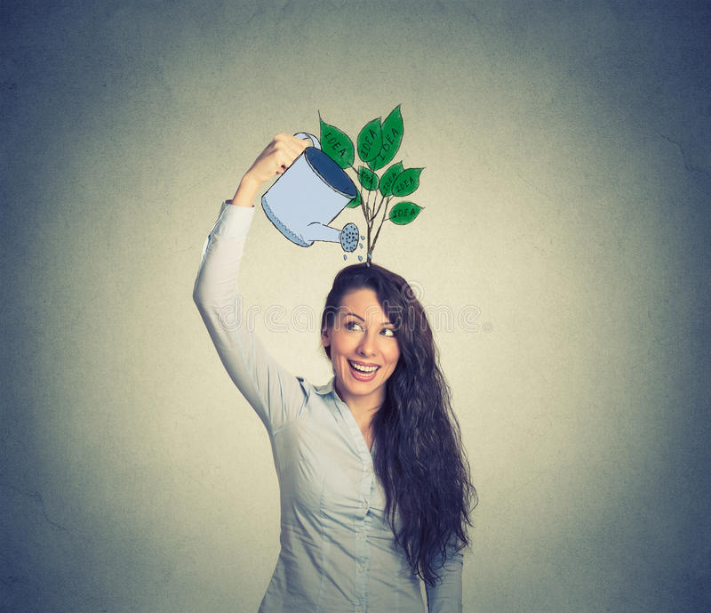 Self investment. Woman with many ideas stock photo