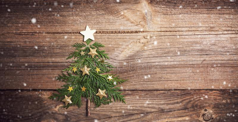 Christmas tree on wooden board with many stars stock photo