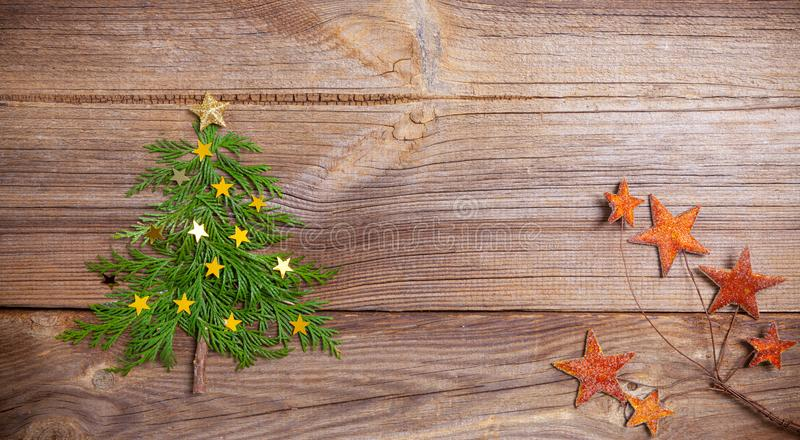 Christmas tree on wooden board with many stars royalty free stock photos