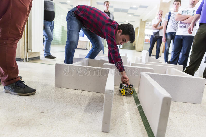 Self-made robot in a maze stock image
