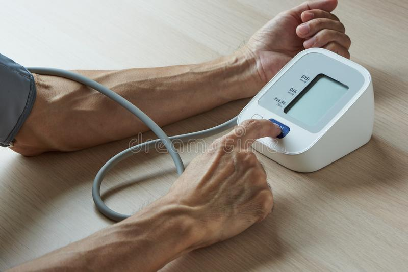 Self measurement of blood pressure at home royalty free stock images