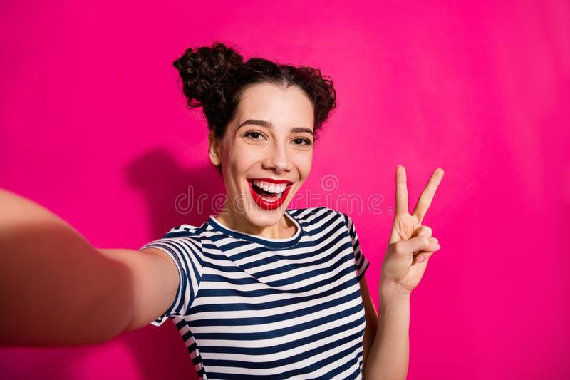 Self photo of cheerful cute nice fascinating girlfriend showing you v-sign taking selfie rejoicing smiling toothily stock images