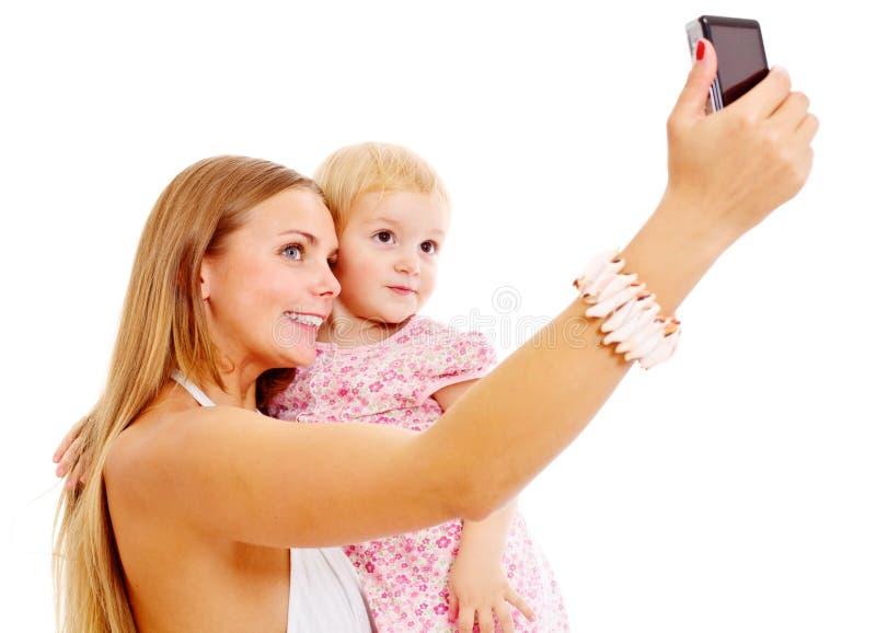Self-portrait av modern och dottern royaltyfria foton