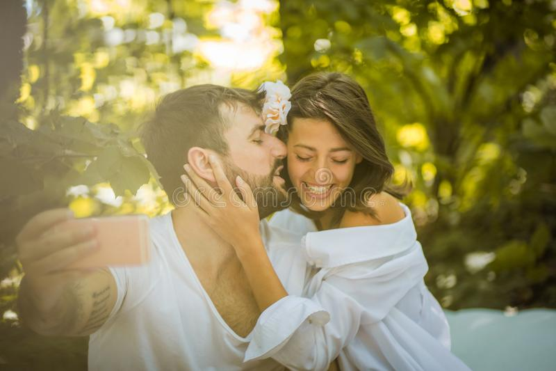 Self portrait of beautiful young couple. stock photo