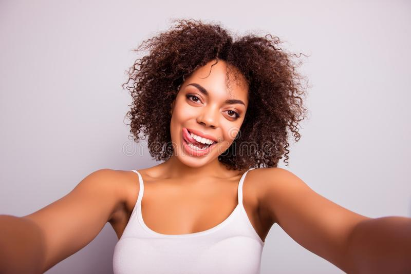 Self portrait of charming, crazy, pretty, sweet, comic, cute attractive girl shooting selfie on front camera with two. Hands, having beaming smile, showing royalty free stock photos