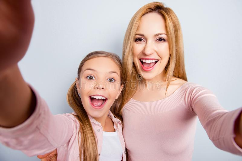 Self portrait of crazy, foolish mother and daughter with open mo stock photos