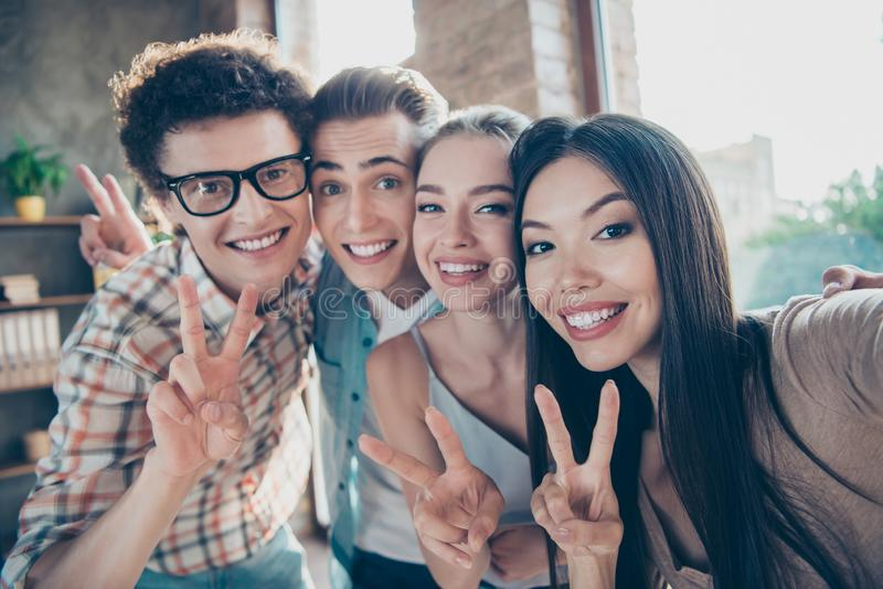 Self-portrait of four cheerful glad adorable people, handsome ne stock photos