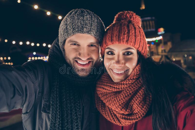 Self-portrait of his he her she nice attractive charming cute lovable lovely cheerful cheery engaged couple wearing warm stock image
