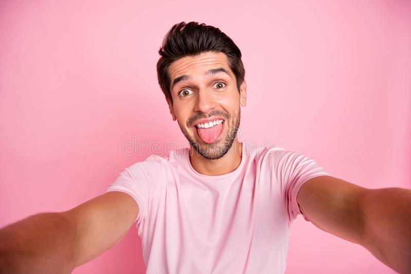 Self-portrait of his he nice attractive lovely cheerful cheery crazy funky guy spending free time fooling having fun. Self-portrait of his he nice attractive stock image