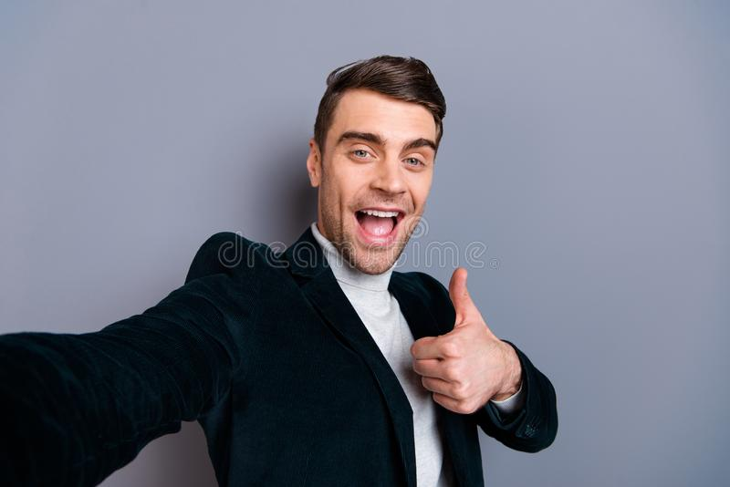Self-portrait of his he nice cute attractive bearded cheerful cheery guy wearing velveteen blazer showing thumbup. Hairdress hairdo haircut isolated over gray stock images