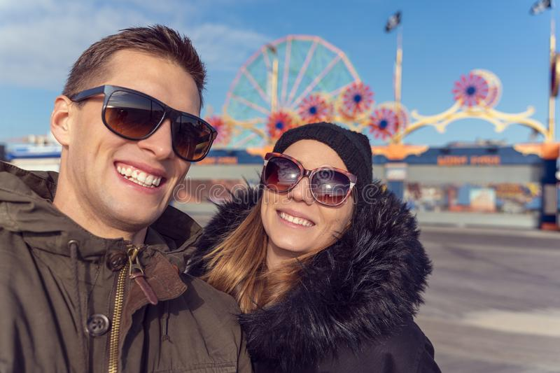 Couple taking a selfie in coney island. Luna park as background royalty free stock photo