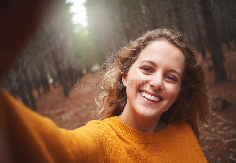 Self portrait of playful smiling young woman royalty free stock photography