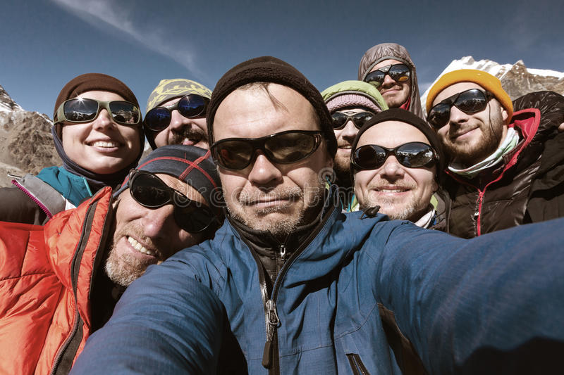 Self Portrait of Team of Mountain Climbers smiling and happy. Self Portrait of friendly Team of Mountain Climbers Men and Woman young and elder in protective royalty free stock images