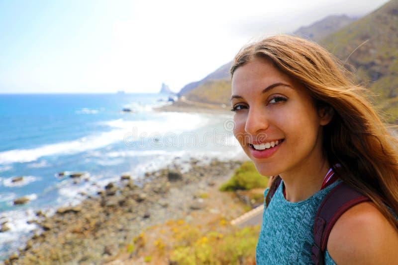 Self portrait of young woman at Playa de Benijo, Tenerife.  royalty free stock photos
