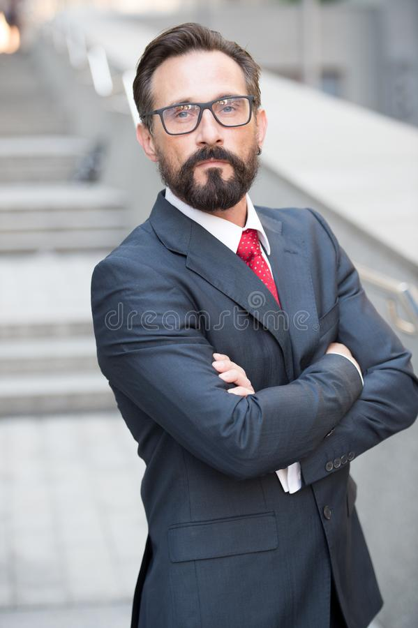 Self possessed businessman standing with his arms crossed royalty free stock image