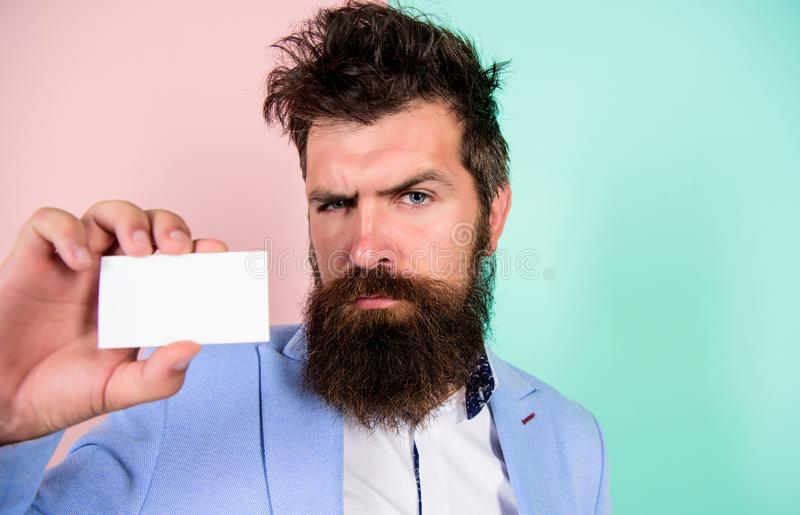 Self presentation. serious bearded man business card. copy space. mature businessman. blank piece of paper. barbershop stock photo
