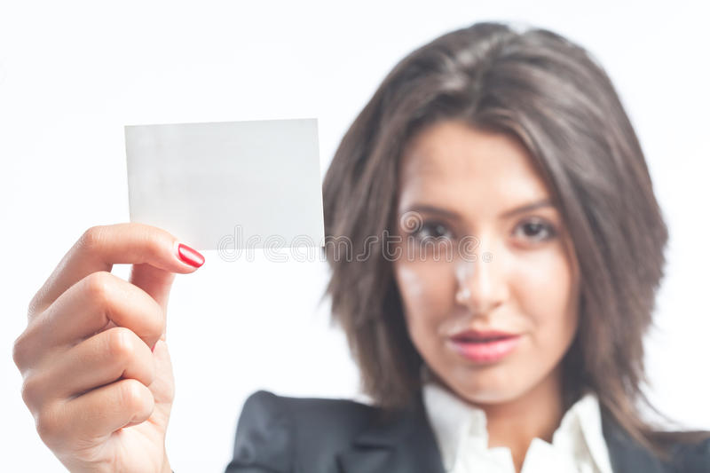 Self promotion. Business woman holding blank visit card - self promotion concept stock photo