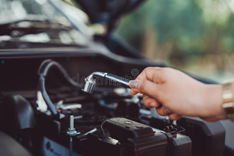 Self service hand use wrench fixing car vehicle,professional. Woman maintenance and repair before travel transportation for reduce accidents safety driving on royalty free stock photos