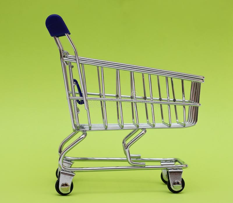 Self-service supermarket full shopping trolley cart on colorful background royalty free stock images