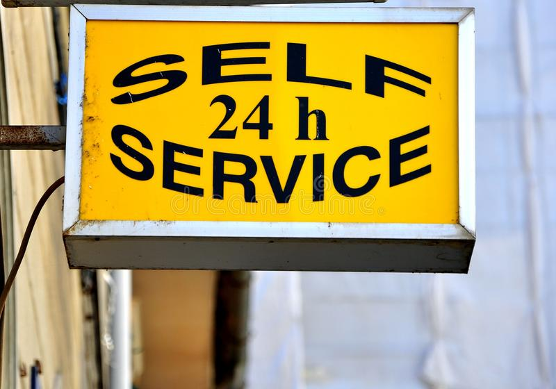 Self sservice 24 h sign. Yellow self service sign for 24 hours. non stop concept stock image