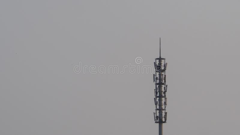 Self Support, Guyed Tower, Guyed Mast, Pole. Telecommunication Tower. Cell Phone Signal Tower on sky background stock photos