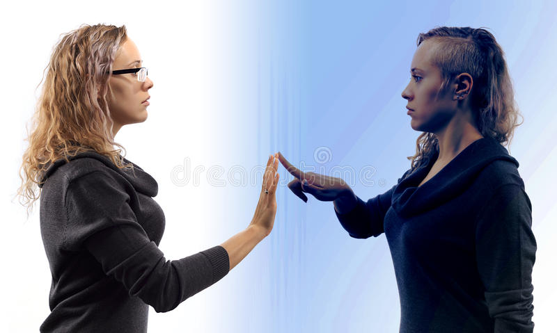 Self talk concept. Young woman talking to herself in mirror reflection. Double portrait from two different side views. Self talk concept. Young blond caucasian royalty free stock images