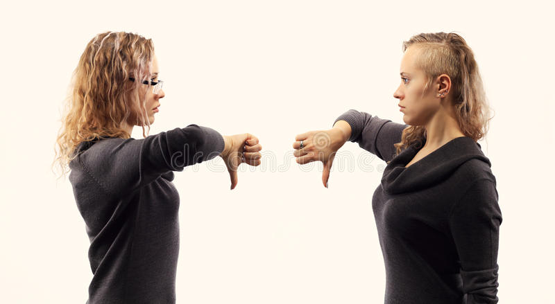 Self talk concept. Young woman talking to herself, showing gestures. Double portrait from two different side views. stock images