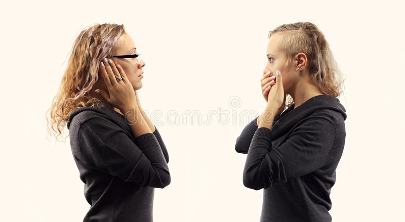 Self talk concept. Young woman talking to herself, showing gestures. Double portrait from two different side views. Part of series. Self talk concept. Young royalty free stock photos