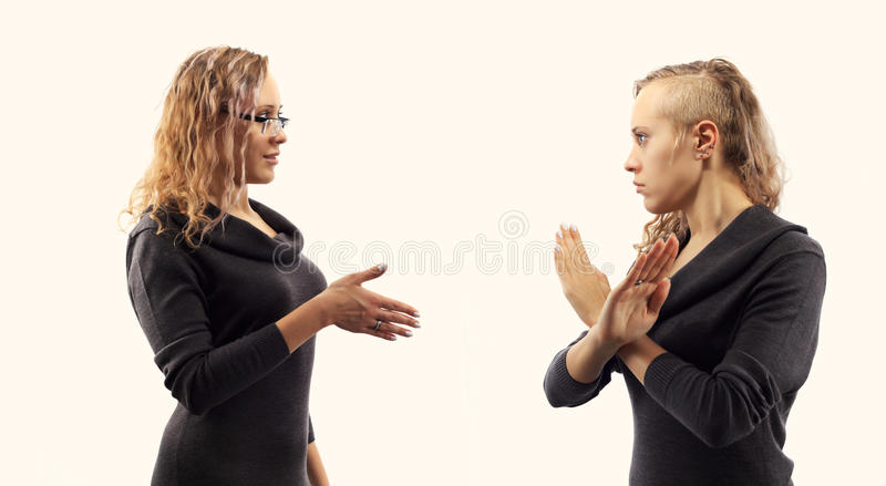 Self talk concept. Young woman talking to herself, showing gestures. Double portrait from two different side views. stock image