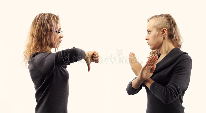 Self talk concept. Young woman talking to herself, showing gestures. Double portrait from two different side views. royalty free stock photo
