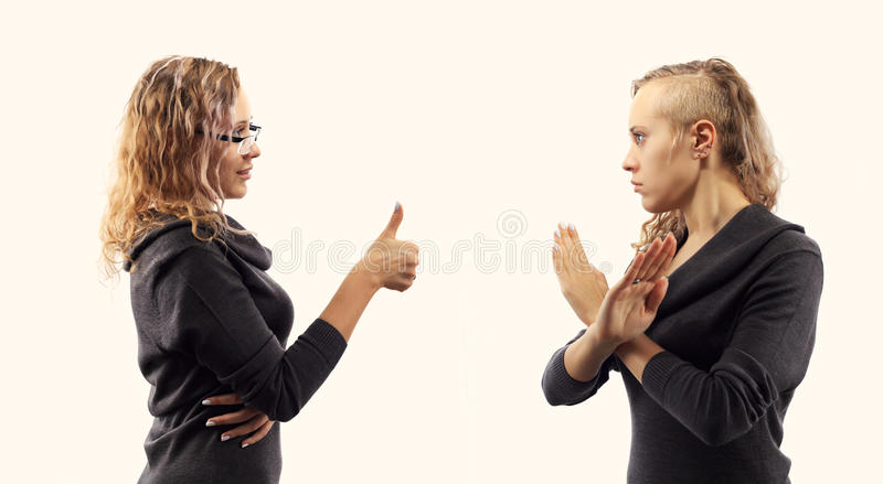 Self talk concept. Young woman talking to herself, showing gestures. Double portrait from two different side views. royalty free stock photography